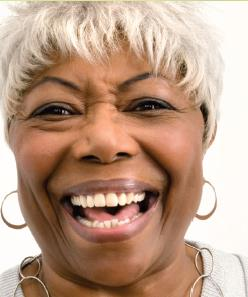 Headshot of senior woman smiling and laughing